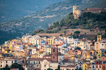 The beautiful village of Bosa with colored houses and a medieval castle on the top of the hill. Bosa is located in the north-west of Sardinia, Italy.