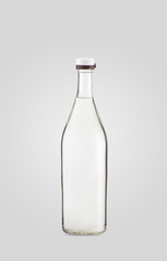 closed transparent bottle of drink on white background with shadow