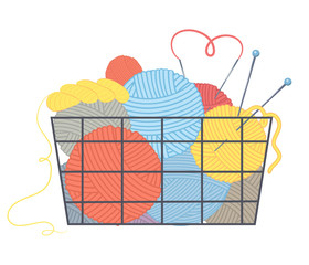 Basket with multi-colored balls of yarn and knitting needles