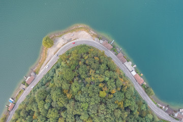Aerial view of lake road in autumn