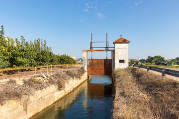 Acequia Real del Jucar - sluicegate of an irrigation watercourse canal at Benifaio, province of Valencia, Spain