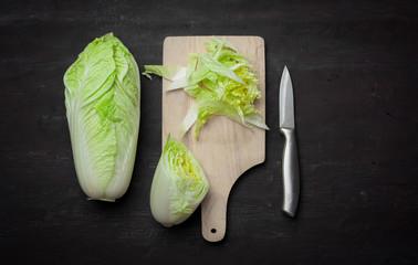 Romain lettuce on kitchen board