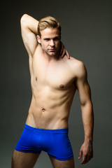 Sexy muscular male model in blue underwear. Handsome shirtless muscular man in boxer shorts. Sexy male model in blue underpants. Muscular young man wearing boxer briefs. Strong man with helathy body.