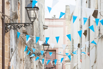 Presicce, Apulia - Blue and white bunting in the streets to celebrate