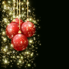 Christmas balls with falling spangles hanging on golden ribbons