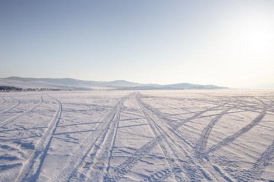 Car track in fresh snow. Lake Baikal