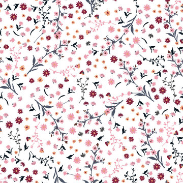 Beautiful wild flowers bright pattern in small-scale pink and red flowers. Liberty style meadow. Floral seamless background for textile, book covers,