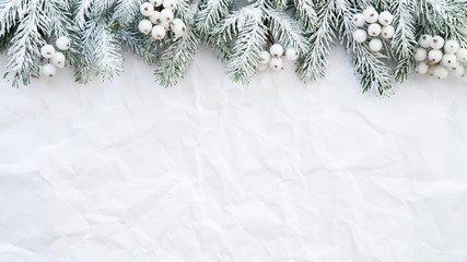 Christmas background with xmas tree on white creased background. Merry christmas greeting card, frame, banner. Winter holiday theme. Happy New Year. Space for text. Flat lay