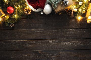 Flat lay Christmas background decoration lights dark wooden background copy space top view