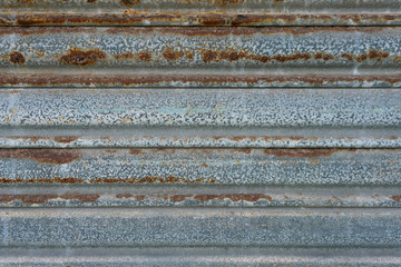 Close up of decaying rusted metal shutter door