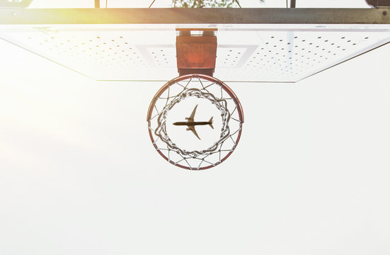 Artistic capture with basket and airplane flying in the sky