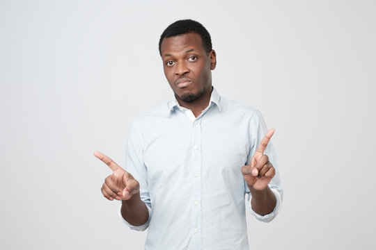 Young african businessman making the no sign with his finger