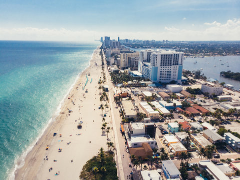 Ocean beach with people coastline view from the top near Miami, Florida