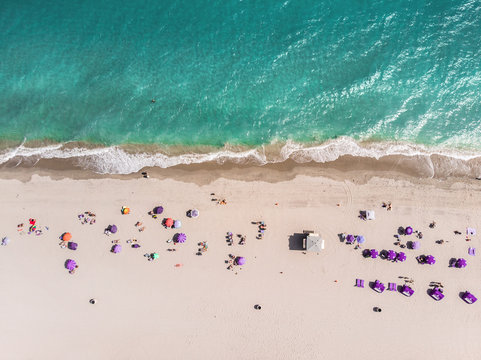 Ocean beach with people coastline view from the top in Miami, Florida