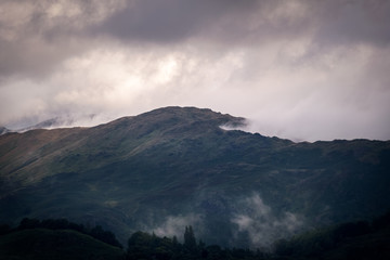 Clouds covering the hills of England in the morning giving mystic scene