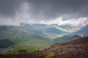 Stunning view into the Little Langdale valley with spots of sunlight lighting the beautiful scene