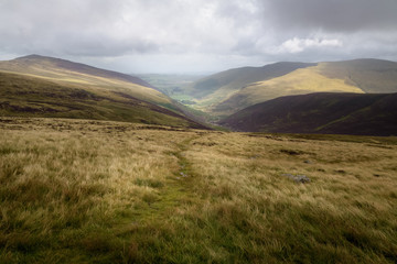 View into the valley from high pike with rough weather England
