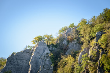 beautiful rock formation light up at golden hour and blue sky Ardennes