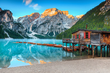 Wall Mural - Spectacular wooden boathouse on the alpine lake, Dolomites, Italy, Europe