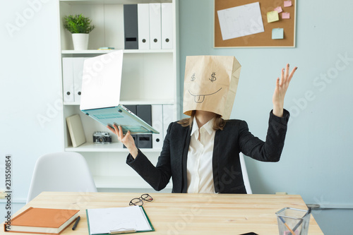 Business, emotions and money concept - office crazy woman