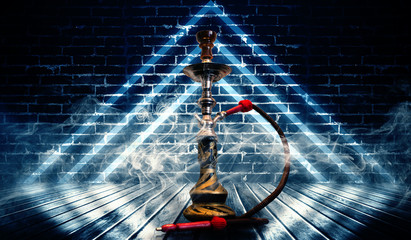 Hookah smoking on the background of an empty grunge wall, neon l