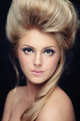 Close-up portrait of beautiful woman with fancy cat eye make-up