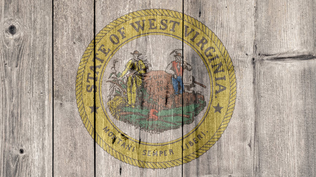 USA Politics News Concept: US State West Virginia Seal Wooden Fence Background