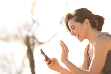 Profile of a happy woman having a video call