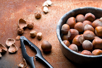 Hazelnuts on a rustic background.