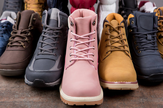 Lots of autumn or winter nubuck leather boots, concept shoes
