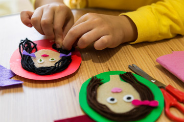 making teacher and student pictures with felt,wool and carton  for children's activities in preschool or nursery.creative ideas for child development.back to school and happy teachers day concept.
