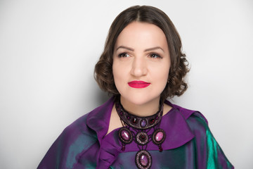 woman brown hair purple blouse