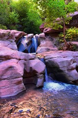 Kanarraville Falls, views from along the hiking trail of falls, stream, river, sandstone cliff formations Waterfall in Kanarra Creek Canyon by Zion National Park, Utah, USA.
