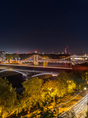 High Resolution Panorama of the Chelsea Bridge in London from Battersea Park at night