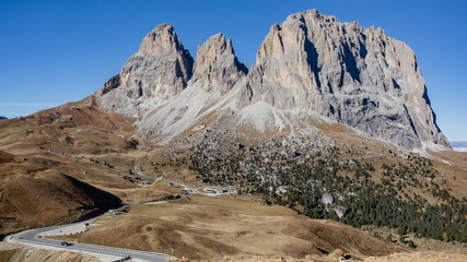 Italy, Dolomites autumn landscape at Passo del Sella serpentines  front of the Langkofel  group mountain peaks