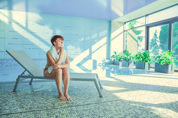 Young woman enjoys wellness and spa