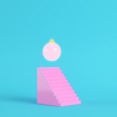 Pink abstract stair with christmas ball on bright blue background in pastel colors