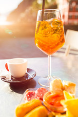 """Aperol Spritz. Traditioanal italian aperitif drink served with some snacks called """"cicchetti"""". Shallow depth of field."""