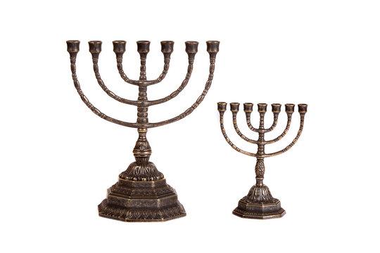 Ritual menorah candlestick on white background