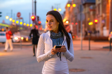 Young woman on the street with a phone