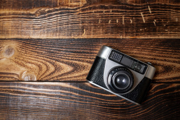 Vintage camera on a wooden table