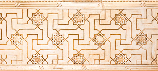 Arabesque decoration in Nasrid palaces in Alhambra. Andalusia, Spain
