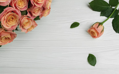 Bouquet of rose flowers on wooden table greeting card template