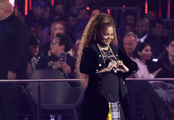 Singer Janet Jackson makes a heart symbol after receiving the Global Icon award at the 2018 MTV Europe Music Awards at Bilbao Exhibition Centre in Bilbao