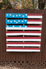 Artistic rendition of an American flag painted on a slatted wooden palette. Downers Grove Illinois IL USA