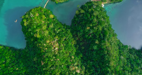 Aerial view of Sugba lagoon. Beautiful landscape with blue sea lagoon, National Park, Siargao Island, Philippines