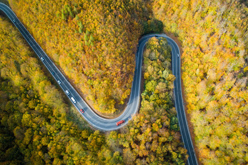 Aerial view of winding road  thorugh Pezinska baba forest in autumn colors, Slovakia