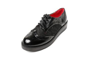 Women's platform black shoes isolated on white background