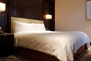 Standard modern hotel room with king size bed