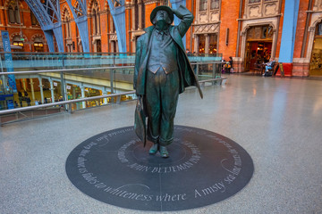 The Betjeman statue of sir John Betjeman at St. Pancras station in London, UK